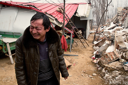 A 50-year-old farmer weeps in front of his ancestral home destroyed by the Chinese government to make way for modern high-rise. <br /> <br /> Communist leaders are pushing ahead with a gigantic, historic plan to uproot 100 million farmers and turn their fields into urban dwellings by year 2020 to create a giant new middle class and boost demand.