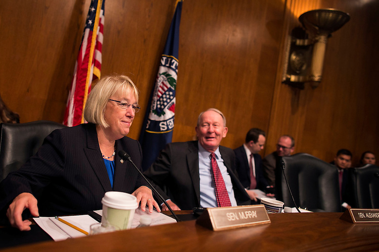 UNITED STATES - October 6: Sen. Patty Murray, D-Wash., and Chairman Lamar Alexander, R-Tenn., joke around prior to the Health, Education, Labor, and Pensions committee hearing to examine the National Labor Relations Board's joint employer decision in the Dirksen Senate office building on Capitol Hill in Washington, on Tuesday, October 6, 2015. (Photo By Al Drago/CQ Roll Call)