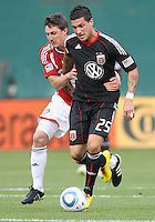 Santino Quaranta #25 of D.C. United  is grabbed by Ben Zemanski #21 of Chivas USA during an MLS match at RFK Stadium, on May 29 2010 in Washington DC. United won 3-2.