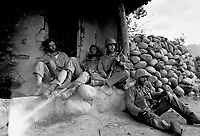 Marines of the 1st Marine Division relax by a Korean hut after destroying an enemy sniper housed there.  September 24, 1951.  T. Sgt. Frank  W. Sewell. (Marine Corps)<br /> NARA FILE #:  127-N-A156980<br /> WAR &amp; CONFLICT BOOK #:  1391