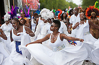 A group of parade participants in festive attire dance along the route of the West Indian American Day Parade held on Monday, September 5, 2011 in Crown Heights, Brooklyn, New York.  The annual Labor Day event, which runs along Eastern Parkway, celebrates West Indian heritage and attracts 2-3 million spectators.