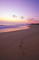 Waimea beach sunset with footprints in the sand, island of Kauai