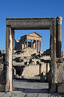 Low angle view of the Capitol, 2nd century, seen through a doorframe on the Roman market, in Dougga, Tunisia, pictured on January 31, 2008, in the morning. Dougga has been occupied since the 2nd Millennium BC, well before the Phoenicians arrived in Tunisia. It was ruled by Carthage from the 4th century BC, then by Numidians, who called it Thugga and finally taken over by the Romans in the 2nd century. Situated in the north of Tunisia, the site became a UNESCO World Heritage Site in 1997. This is one of the best preserved Roman temples in North Africa with a portico of six Corinthian columns. The market was initially a place for trading slaves. The door is left of one of the largest house of Dougga, called Dar el Acheb. Picture by Manuel Cohen.