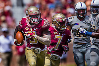 TALLAHASSEE, FLA 9/10/16-Florida State's Jesus &quot;Bobo&quot; Wilson, left, gets some protection from Ryan Green, center, as he makes his 89-yard punt return for the Seminole's fourth touchdown against Charleston Southern during first quarter action Saturday at Doak Campbell Stadium in Tallahassee. <br /> COLIN HACKLEY PHOTO