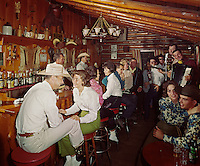 Bit & Bridle, Stoney Creek, NY. Couples enjoying the music in the cowboy bar.