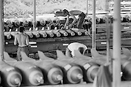 June 1972, Guam --- The Andersen Air Force Base on Guam Island from where the B-52 Stratofortress planes take off for Vietnam. Bombs are prepared before being put in the B-52's store-room. --- Image by © JP Laffont/Sygma/Corbis