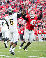 The Georgia Bulldogs beat the App State Mountaineers 45-6 in their homecoming game.  After a close first half, UGA scored 31 unanswered points in the second half.  Appalachian State Mountaineers quarterback Kameron Bryant (5) passes over Georgia Bulldogs defensive end Ray Drew (47)