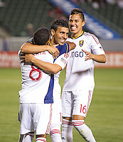 CARSON, CA - May 19, 2012: Real Salt Lake midfielder Javier Morales (11) and Real Salt Lake defender Carlos Salcedo (16) congratulate Real Salt Lake forward Jou Plata (8) on his goal during the Chivas USA vs Real Salt Lake match at the Home Depot Center in Carson, California. Final score, Chivas USA 1, Real Salt Lake 4.