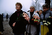 Ostpreu Bendamm, West Germany<br /> November 14, 1989 <br />  <br /> A West German women hold flowers to greet East Germans at the opening of the Berlin Wall. Germans gathered as the wall is dismantled and the East German government lifts travel and emigration restrictions to the West on November 9, 1989.