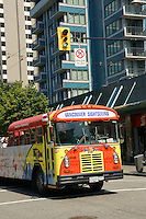 Sightseeing bus on Robson Street in downtown Vancouver, British Columbia, Canada