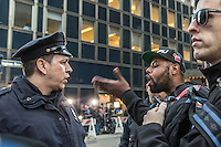 vPolice discussing with one of the assistants at the anti-Trump protest near to Grand Central in midtown Manhattan on April 14,2016 in New York City. Photo by VIEWpress/Maite H. Mateo