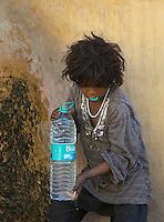 Boy getting water Jaipur, Rajasthan