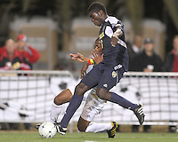 Darlington Naqbe #6 of the University of Akron clashes with Kofi Opare #6 of the University of Michigan during the 2010 College Cup semi-final at Harder Stadium, on December 10 2010, in Santa Barbara, California. Akron won 2-1.