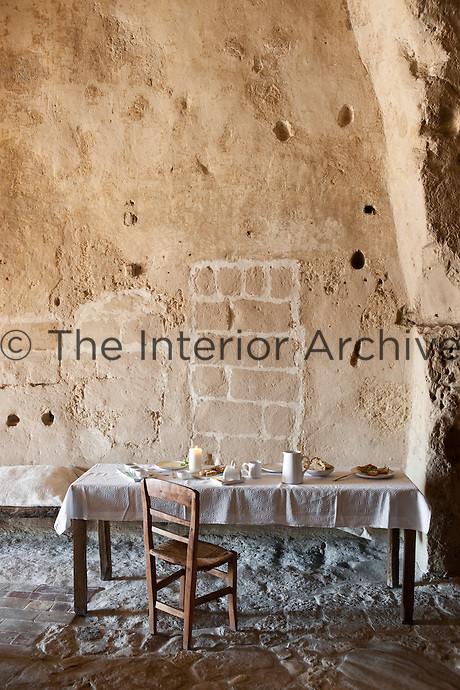 A laid table for breakfast in one of the suites at the Albergo Diffuso Le Grotte della Civita built within ancient caves in the town of Matera in Southern Italy