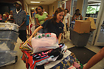 Morgan Leigh Dykes of Montgomery, Ala. moves her belongings  into Stockard-Martin Dorm at the University of Mississippi in Oxford, Miss. on Friday, August 19, 2011. Classes begin on Monday, August 22, 2011.