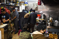The busy kitchen staff at Dhaulagiri Kitchen, a tiny Nepalese restaurant in Jackson Heights. <br /> <br /> Danny Ghitis for The New York Times