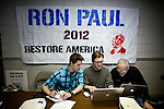 Volunteer Robert Terhune, center, signs up volunteers at Ron Paul's presidential campaign headquarters in Reno, Nev., January 31, 2012.