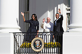 United States First Lady Michelle Obama, Pope Francis and President Barack Obama wave from the balcony at the conclusion of the Official State Welcome ceremony for Pope Francis at The White House in Washington, DC on Wednesday, September 23, 2015.  <br /> Credit: Chris Kleponis / CNP