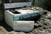 Cooking stove found in the debris left by huricane Stan.  Miguel de la Madrid neighbourhood, Tapachula, Chiapas.