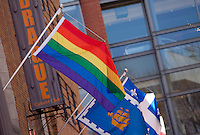 The Rainbow flag (also known as Pride flag or Gay flag) and the Quebec city flag are seen on Le Drague cabaret club in Quebec city May 4, 2009. Bar le Drague is the flagship of the gay community district of Quebec city (Quartier gai de Quebec, Gay Quarter of Quebec).