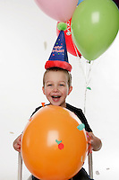 Tucker Ward 5 year old birthday boy photo in studio celebrating with balloons.