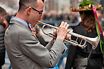 A man plays the trumpet as part of a small band that set up to play music for the crowd during the Easter Parade in New York City on Fifth Avenue