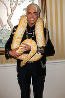 BEVERLY HILLS, CA, USA - MARCH 28: KUBA Ka at the Versace Unveiling Of The 1st Pop Recording Artist Superhero - KUBA Ka's Performance Outfits. Designed by the legendary fashion hosuse - Donatella Versace. For the Benefit of the Face Forward Foundation (Plastic Surgery for Destroyed Faces from Violence). Pop entertainer TV personality KUBA Ka, together with VERSACE, unveiled Kuba Ka's new Versace images, for the First Pop Artist/Superhero of the World. He has become the inspiration of Donatella's newest and wildest creations and will celebrate the launch of his new power house conglomerate - KUBA Ka Empire Inc. in collaboration with the sensational fashion house - VERSACE on Friday, his birthday at a red carpet media and celebrity event at the luxurious Peninsula Hotel in Beverly Hills held at the Peninsula Hotel on March 28, 2014 in Beverly Hills, California, United States. (Photo by Xavier Collin/Celebrity Monitor)