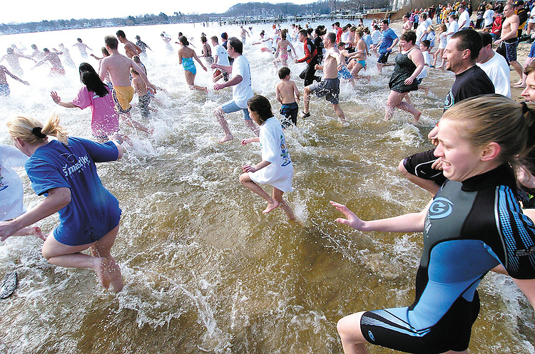 Sentinel/Dan Irving.About 200 people rush into the chilly waters of Lake Macatawa Saturday morning to help raise money for the A-T Children's Project..(3/26/05).
