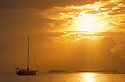 Sailing yacht anchored in bay at sunset on Culebra Island, Puerto Rico, with Cayo de Luís Peña on horizon across the channel.