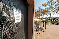 A sign on Castle Clinton National Memorial in Battery Park in New York informs tourists that the attraction is closed, seen on Tuesday, October 1, 2013. A partial government shutdown took effect today because of a dispute between Democrats and Republicans in Congress over the Obamacare program. Approximately 800,000 federal workers have been furloughed and only essential services are up and running.  © Richard B. Levine)