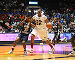 "Ole Miss' Nikki Byrd (22) drives for two points vs. North Florida's Jasmine Hicks (30) and Fabiola Josil (1) at the C.M. ""Tad"" Smith Coliseum in Oxford, Miss. on Friday, November 11, 2011."