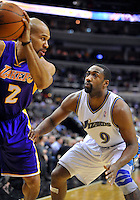 Gilbert Arenas of the Wizards plays defense against Lakers' Derek Fisher. Los Angeles defeated Washington 103-89 at the Verizon Center in Washington, DC on Tuesday, December 14, 2010. Alan P. Santos/DC Sports Box