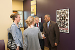 Ohio University President Roderick McDavis (Right) greets Ohio Attorney General Mike DeWine and members of his family at Ohio University's Women's Center. Photo by Ben Siegel/ Ohio University