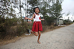 Nguyen Thi Ly, 11, skips rope in her village south of Da Nang, Vietnam. Her grandfather served in the North Vietnamese Army during the Vietnam War, and she is a third generation victim of dioxin exposure, the result of Agent Orange and other herbicides sprayed by the U.S. military during the conflict more than 40 years ago. Like her mother, she suffers from severe facial deformities and chronic bone pain, but is otherwise a normal little girl with hopes and dreams for the future. Skipping rope is her favorite activity. The Vietnam Red Cross estimates that 3 million Vietnamese suffer from illnesses related to dioxin exposure, including at least 150,000 people born with severe birth defects since the end of the war. The U.S. government is paying to clean up dioxin-contaminated soil at the Da Nang airport, which served as a major U.S. base during the conflict. But the U.S. government still denies that dioxin is to blame for widespread health problems in Vietnam and has never provided any money specifically to help the country's Agent Orange victims. May 28, 2012.