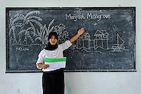 Teacher during an environmental education class, Dudepo, Bolmong Selatan, Sulawesi, Indonesia.