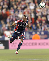 New England Revolution defender Andrew Farrell (2) heads the ball.  In a Major League Soccer (MLS) match, the New England Revolution (blue) defeated Columbus Crew (white), 3-2, at Gillette Stadium on October 19, 2013.