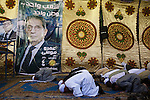 Supporters of Egyptian presidential candidate Amr Moussa take time to pray before the start of a May 16, 2012 campaign stop in the village of Khanka on the outskirts of Cairo, Egypt. Moussa is currently the front-runner in the upcoming Egyptian presidential elections that will take place across the country May 23-24, 2012. (Photo by Scott Nelson)