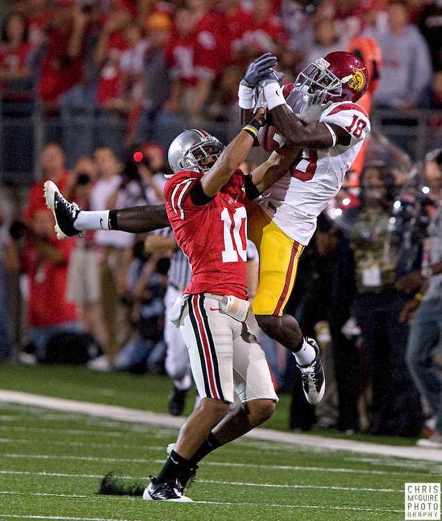 12 September 2009:  Football -- USC wide receiver Damian Williams goes up for a catch against Ohio State defensive back Devon Torrence during their game at Ohio Stadium in Columbus.  The pass was incomplete.  USC won 18-15.  Photo by Christopher McGuire.