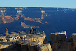 Visitors at sunrise at south rim
