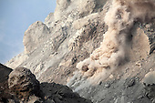 Small rockfall on flank of Rerombola lava dome of Paluweh volcano during 2012 eruption, Flores, Indonesia.