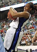 Karima Christmas fights for the ball in the second half. This was the Championship game of the 2011 ACC Tournament in Greensboro on March 6, 2011. Duke beat UNC 81-66. (Photo by Al Drago)
