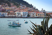 """Gythio, Mani, Peloponnesos, Greece, May 2013. Gythio is located in middle south of Peloponese at the center of the Laconian Gulf. It is a lively, charming little harbour town. The most of its houses are two- or three-storey neo-classical mansions, stuck to the steep side of the Mt. """"Koumaros"""". A long sea-side promenade, the colourful fishing boats, the narrow streets and stairways produce a typical Greek environment. The southern and middle tips of the Peloponnesos are called The Mani. This isolated region in the districts of Lakonia and Messinia is littered with Byzantine era churches and Ottoman era tower house villages. The Peloponnese peninsula is the real heart of traditional Greece. Ancient mountain villages interrupt the olive groves that line the rugged coastline that is surrounded by deep blue and turquoise waters of the Mediterranean.  Photo by Frits Meyst/Adventure4ever.com"""