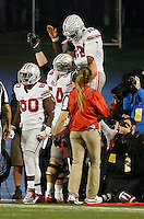 Ohio State Buckeyes offensive lineman Billy Price (54) lifts quarterback J.T. Barrett (16) after he ran for a touchdown during the fourth quarter of the NCAA football game at Camp Randall Stadium in Madison, Wisconsin on Oct. 15, 2016. Ohio State won 30-23. (Adam Cairns / The Columbus Dispatch)