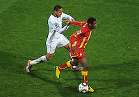 Ricardo Clark of USA is hit in the face by the stray hand of Asamoah Gyan of Ghana. USA vs Ghana in the 2010 FIFA World Cup at Royal Bafokeng Stadium in Rustenburg, South Africa on June 26, 2010.