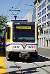 Sacramento lightrail system trains running downtown.