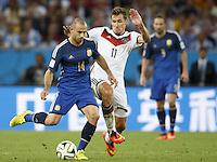Javier Mascherano of Argentina and Miroslav Klose of Germany