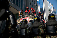 """""""Red Shirt"""" protesters are met by soldiers in riot gear in Ploenchit, one of Bangkok's busy business areas in the city centre."""