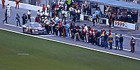 Rival crewmen line up to congratulate Dale Earnhardt after he won the 1998 Daytona 500 at Daytona INternational Raceway, Daytona Beach, FL, February 15, 1998.  (Photo by Brian Cleary/www.bcpix.com)