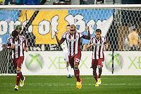 Jose Correa (27) of CD Chivas USA celebrates scoring during the first half against the Philadelphia Union during a Major League Soccer (MLS) match at PPL Park in Chester, PA, on July 12, 2013.