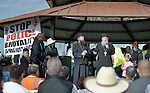 Archpriest Seraphim Bell of the Saint John (Russian) Orthodox Church in Kennewick, Washington, speaks at a February 14 2015 rally in Pasco, Washington, that demanded justice for the killing of Antonio Zambrano Montes by three Pasco police officers on February 10. Beside him is Priest Jesse Philo.